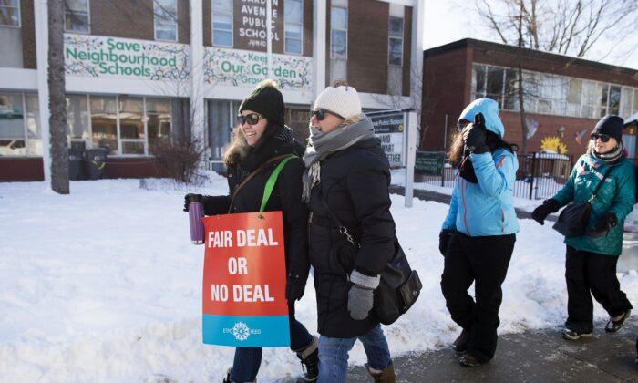 Teachers of the Elementary Teachers' Federation of Ontario participate in a full withdrawal-of-services strike in Toronto on Jan. 20, 2020. (The Canadian Press/Nathan Denette)