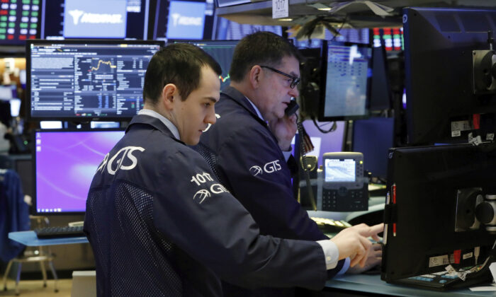Specialists prepare for the day's trading activity on the floor of the New York Stock Exchange, on Monday, March 2, 2020. (Richard Drew/AP Photo)