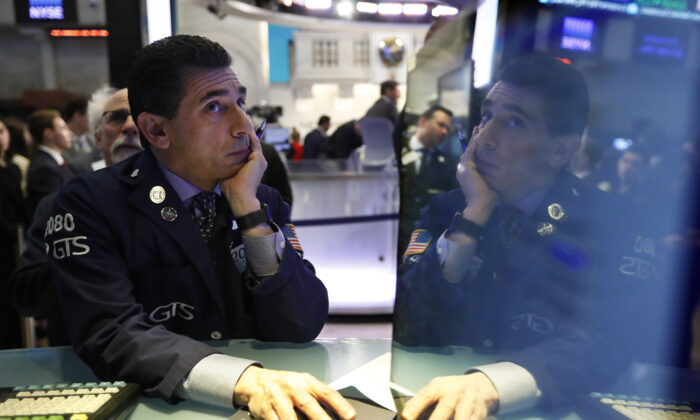Specialist Peter Mazza works on the floor of the New York Stock Exchange, Monday, March 2, 2020. (Richard Drew/AP Photo)