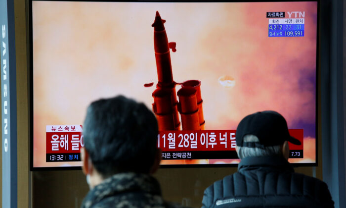 People watch a TV showing a file picture for a news report on North Korea firing two unidentified projectiles, in Seoul, South Korea on March 2, 2020. (Heo Ran/Reuters)