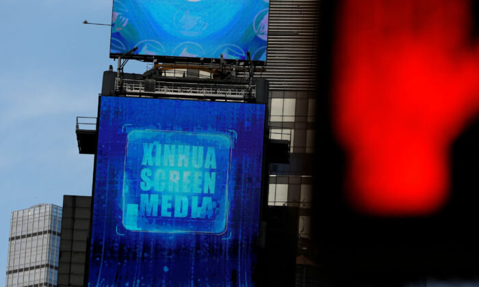 A screen advertising Xinhua News Agency is seen in Times Square in Manhattan, New York City, on March 2, 2020. (Andrew Kelly/Reuters)