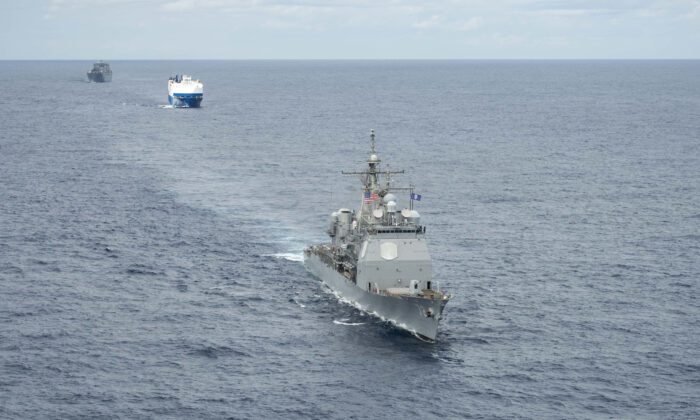 A convoy comprised of the Ticonderoga-class guided-missile cruiser USS Vella Gulf (CG 72) (R), the vehicle carrier MV Resolve (C), and the Military Sea Lift Command (MSC) roll-on roll-off cargo ship USNS Benavidez (T-AKR 306) steam in formation.  (U.S. Navy Photo by Mass Communication Specialist 3rd Class Andrew Waters/Released)