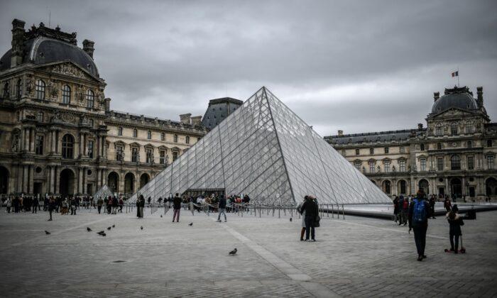 People visit the Louvre Pyramide on Feb. 28, 2020 in Paris. (Stephane de Sakutin/AFP via Getty Images)