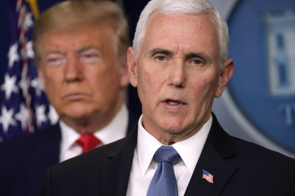U.S. President Donald Trump listens as Vice President Mike Pence