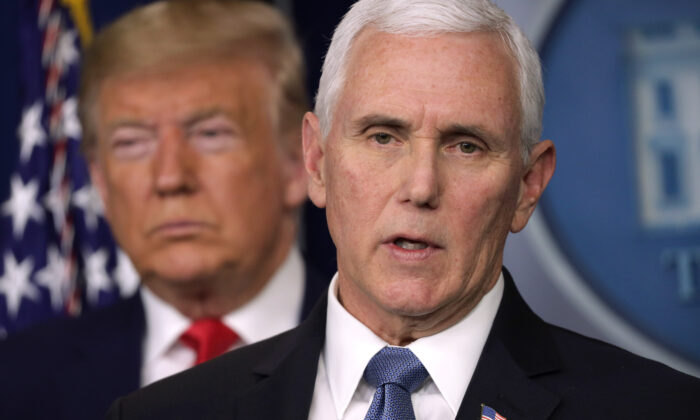 U.S. President Donald Trump listens as Vice President Mike Pence speaks during a news conference at the James Brady Press Briefing Room at the White House on Feb. 29, 2020 in Washington. (Alex Wong/Getty Images)