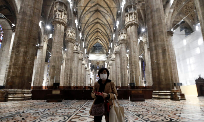 A tourist visits Milan's Duomo cathedral in Milan, Italy, on March 2, 2020. (Yara Nardi/Reuters)