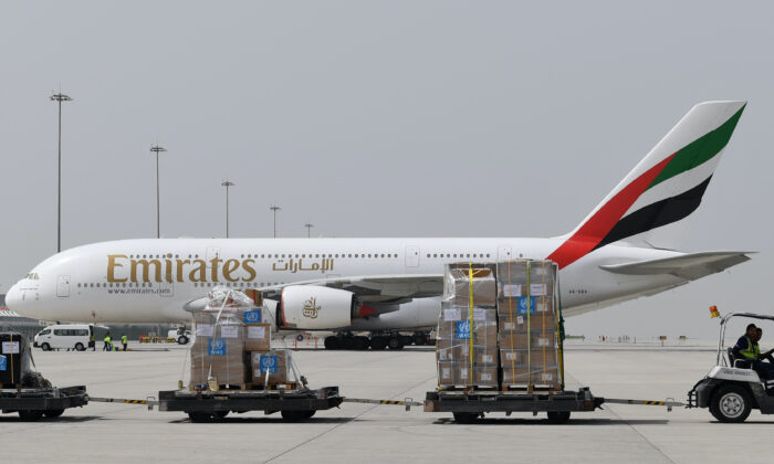 Tonnes of medical equipment and coronavirus testing kits provided by the World Health Organisation are pictured passing by an Emirates airlines Airbus A380-861, at the al-Maktum International airport in Dubai on March 2, 2020. (Karim Sahib/AFP via Getty Images)