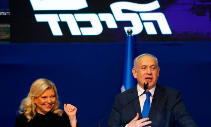Israeli Prime Minister Benjamin Netanyahu addresses supporters, as his wife, Sara, looks on, at the Likud party campaign headquarters in the coastal city of Tel Aviv, Israel, on March 3, 2020.  JACK GUEZ/AFP via Getty Images
