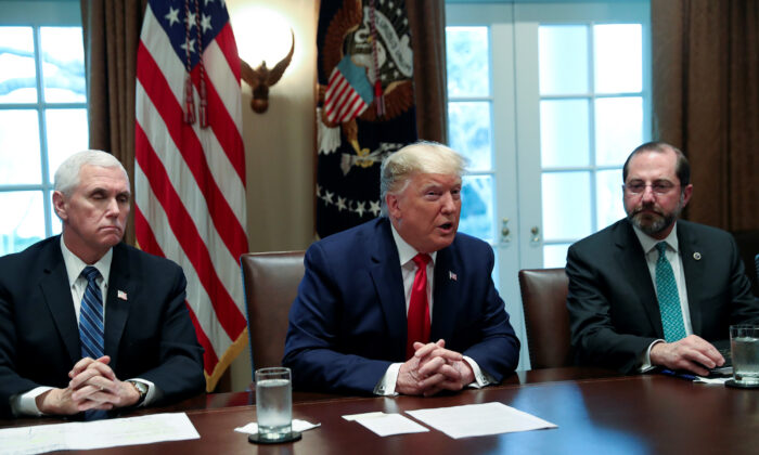 President Donald Trump, flanked by Vice President Mike Pence (L) and Secretary of Health and Human Services Alex Azar (R), speaks during a meeting with the White House Coronavirus Task Force and pharmaceutical executives at the White House in Washington, on March 2, 2020. (Leah Millis/Reuters)