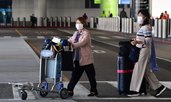 Women wear face masks at Los Angeles International Airport in California on March 2, 2020. (Frederic J. Brown/AFP via Getty Images)