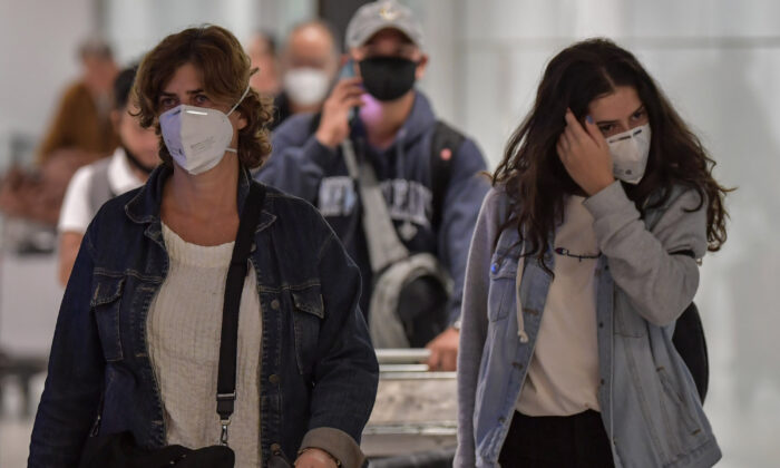Passengers wearing masks arrive on a flight from Italy at Guarulhos International Airport, in Guarulhos, Sao Paulo, Brazil on March 2, 2020. (Nelson Almeida/AFP via Getty Images)