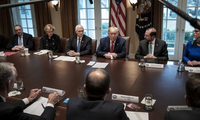 Flanked by Vice President Mike Pence (L) and Secretary of Health and Human Services Alex Azar, President Donald Trump leads a meeting with the White House Coronavirus Task Force and pharmaceutical executives in Cabinet Room of the White House in Washington on March 2, 2020. (Drew Angerer/Getty Images)