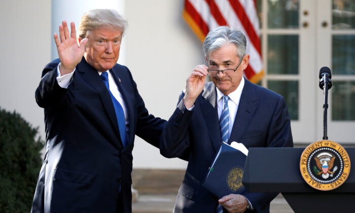 President Donald Trump gestures with then-nominee for Federal Reserve Chairman Jerome Powell, at the White House in Washington, on Nov. 2, 2017. (Reuters/Carlos Barria)
