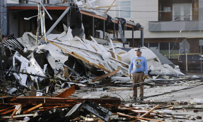 A man looks over buildings destroyed by storms in Nashville, Tenn., on March 3, 2020. (Mark Humphrey/AP Photo)
