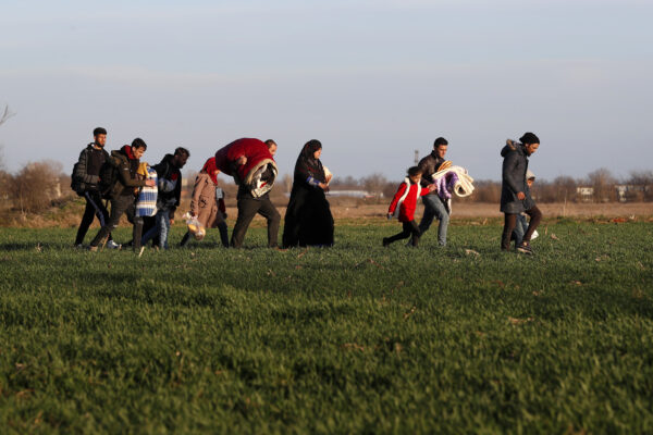 Migrants walk near the Pazarkule border crossing in Edirne, at the Turkish-Greek border on Monday, March 2, 2020. (Darko Bandic/AP Photo)