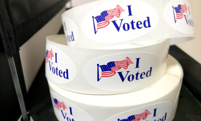 A roll of voter stickers at Santa Ana Downtown Plaza voting center on March 3, 2020. (Chris Karr/The Epoch Times)