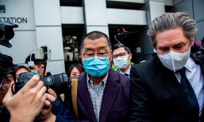 Hong Kong media tycoon and founder of Apple Daily newspaper Jimmy Lai (C) leaves the Kowloon City police station in Hong Kong on Feb. 28, 2020. (Isaac Lawrence/AFP via Getty Images)