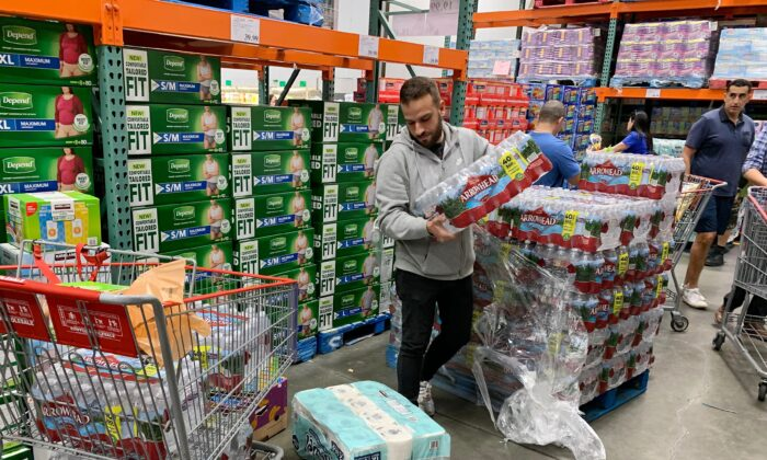 A man buys water, food, and toilet paper at a store in Los Angeles on Feb. 29, 2020. (Mark Ralston/AFP via Getty Images)