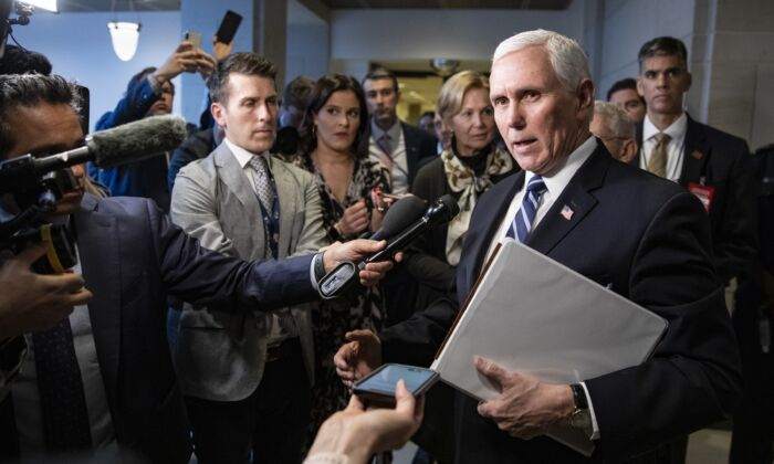 U.S. Vice President Mike Pence stops to talk to reporters briefly as he leaves the US Capitol after meeting with Congressional Democrats and Republicans, in separate closed-door meetings, on recent developments with the novel coronavirus, or COVID-19 in Washington, DC on March 4, 2020. (Samuel Corum/Getty Images)