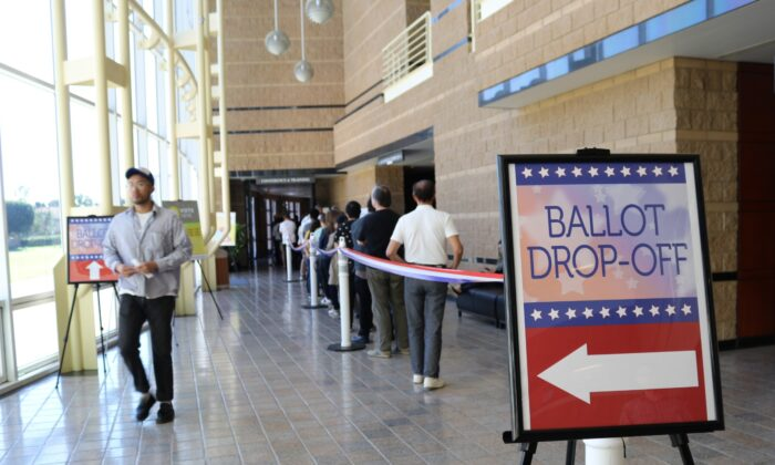 Voters line up at the Irvine Valley College voting center in Irvine, Orange County, on March 3, 2020. (Jamie Joseph/The Epoch Times)