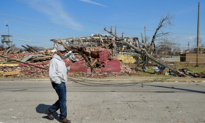 A resident of the Germantown neighborhood is seen surveying the damage in Nashville, Tenn., on March 3, 2020. (Jason Kempin/Getty Images)