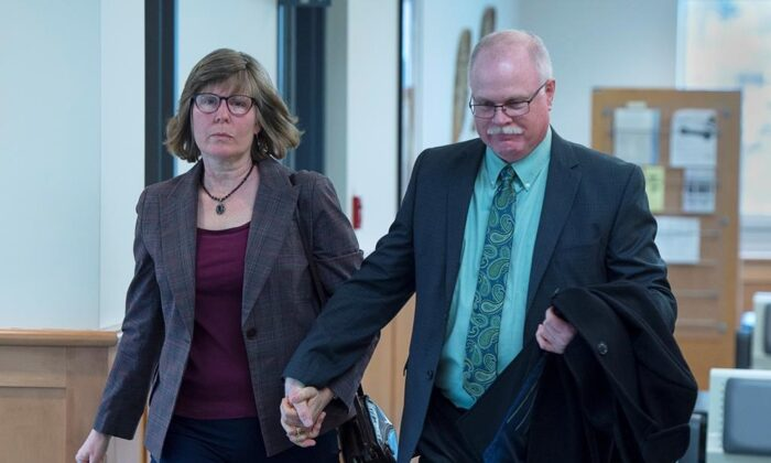 John Collyer, former Bridgewater police chief, heads into Nova Scotia Supreme Court for his sentencing with his wife Sheri Collyer in Bridgewater, N.S., on March 4, 2020. (Andrew Vaughan/The Canadian press)