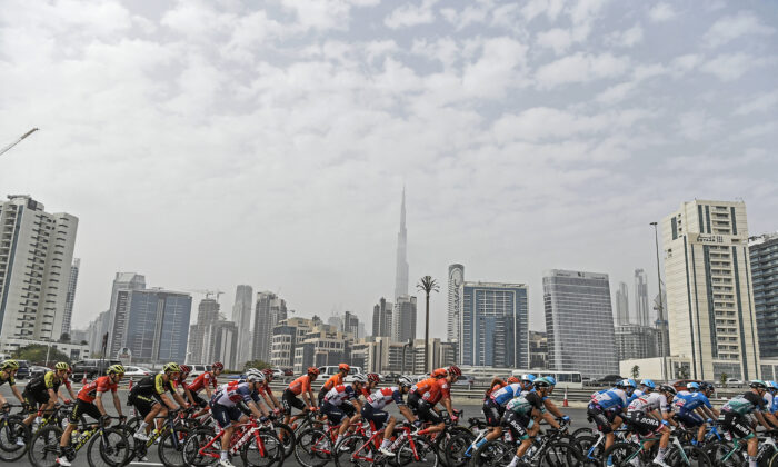 The pack pedals during the fourth stage of the tour of United Arab Emirates cycling race, from Zabeel Park to Dubai City Walk, in United Arab Emirates on Feb. 26, 2020. (Massimo Paolone/LaPresse via AP)