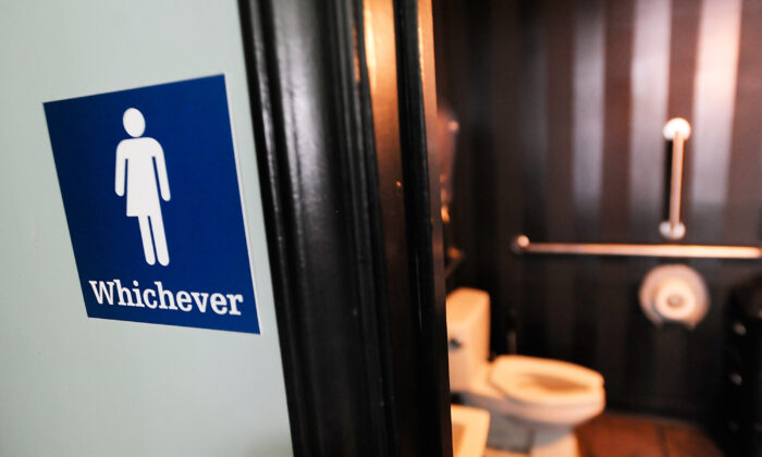 A gender neutral sign is posted outside a bathrooms at Oval Park Grill in Durham, North Carolina on May 11, 2016. (Sara D. Davis/Getty Images)