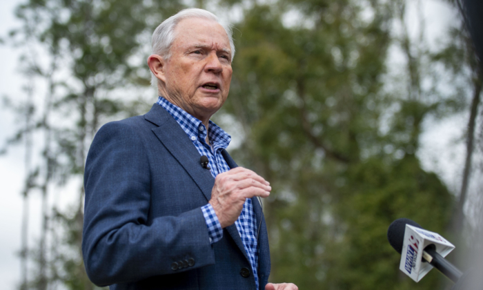 Jeff Sessions talks with the media after voting in Alabama's state primary in Mobile, Ala., on March 3, 2020. (Vasha Hunt/AP Photo)