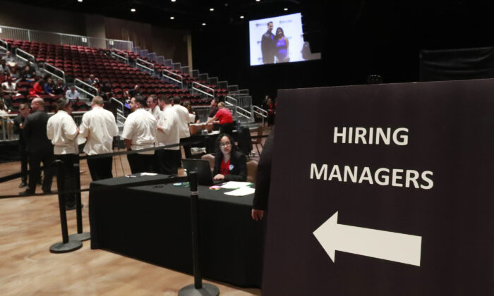 Managers wait for job applicants at a job fair in Hollywood, Fla., on June 4, 2019. (Wilfredo Lee/AP Photo)