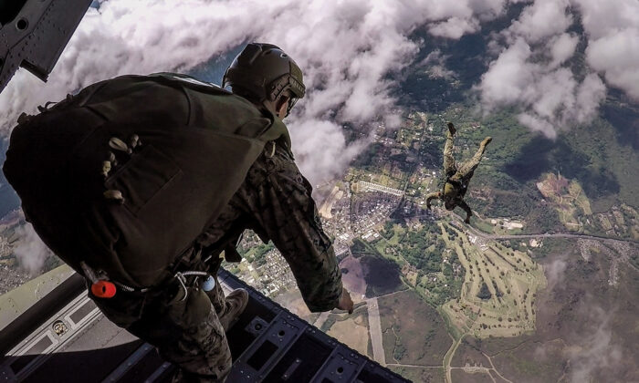 Marines with the Maritime Raid Force, 11th Marine Expeditionary Unit, conduct military free-fall training over Marine Corps Training Area Bellows, Oahu, Hawaii. (U.S. Marine Corps photo by Lance Cpl. Devan K. Gowans)