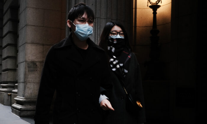 A couple in medical masks walk through the financial district in Manhattan in New York City on March 3, 2020. (Spencer Platt/Getty Images)