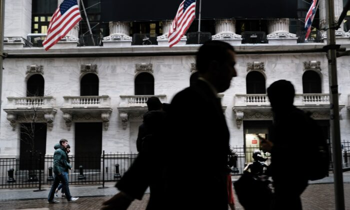 People walk by the New York Stock Exchange in New York City on March 3, 2020. (Spencer Platt/Getty Images)