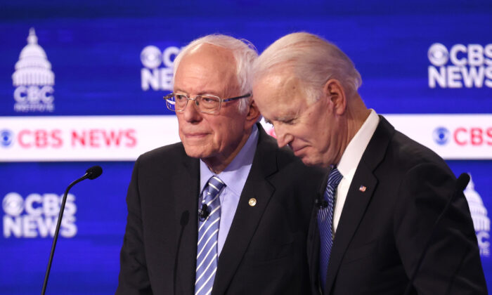 Democratic presidential candidates Sen. Bernie Sanders (I-Vt.) and former Vice President Joe Biden speak during a break at the Democratic presidential primary debate at the Charleston Gaillard Center n Charleston, S.C., on Feb. 25, 2020. (Win McNamee/Getty Images)