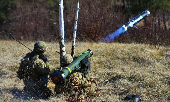 U.S. Army Spc. Fernando Jimenez, right, engages a target with a Javelin shoulder fired anti-tank missile during a live-fire as part of Exercise Rock Sokol at Pocek Range in Postonja, Slovenia, March 9, 2016. (Army photo by Paolo Bovo / Department of Defense)