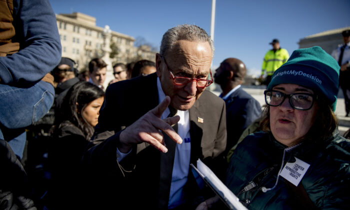 Senate Minority Leader Sen. Chuck Schumer (D-N.Y.) arrives to speak to abortion demonstrators at a rally outside the Supreme Court in Washington on March 4, 2020. (Andrew Harnik/AP Photo)