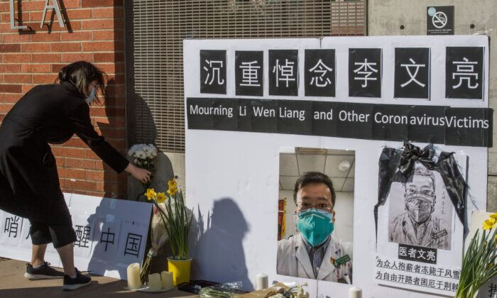 Chinese students and their supporters hold a memorial for Dr Li Wenliang, who was the whistleblower of the coronavirus that originated in Wuhan, China, and caused the doctor's death in that city, outside the UCLA campus in Westwood, Calif., on Feb. 15, 2020. (MARK RALSTON/AFP via Getty Images)
