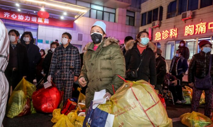 Patients infected by the COVID-19 coronavirus wait to be transferred from Wuhan No.5 Hospital to Leishenshan Hospital, the newly-built hospital for the COVID-19 coronavirus patients in Wuhan, China on March 3, 2020. (STR/AFP via Getty Images)