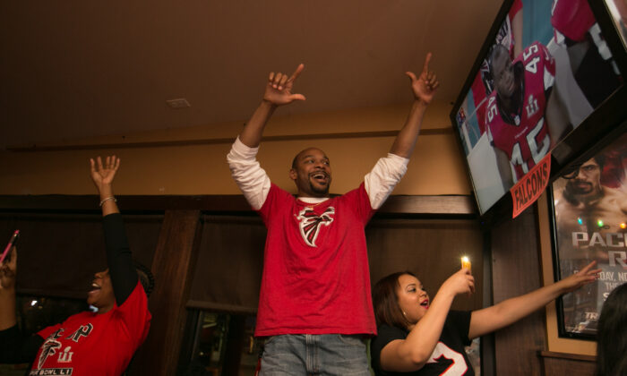 Atlanta Falcons fans celebrate a touchdown by the Falcons while watching Super Bowl 51 against the New England Patriots at Dugan's Bar in Atlanta, Ga., on Feb. 5, 2017. (Jessica McGowan/Getty Images)