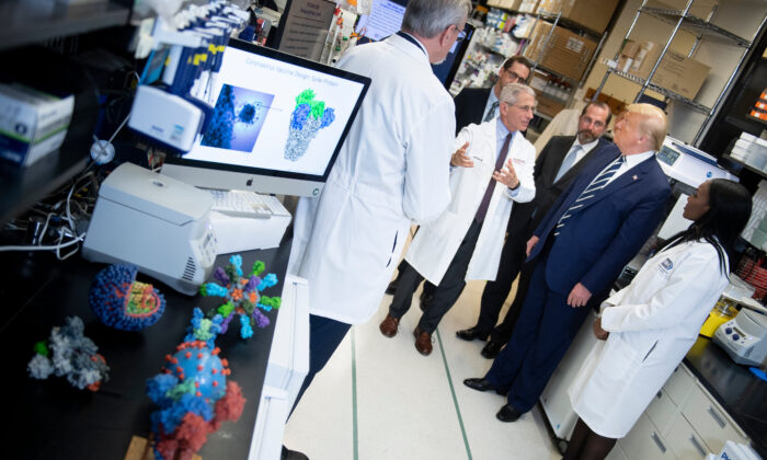 National Institute of Allergy and Infectious Diseases Director Dr. Anthony Fauci speaks to President Donald Trump during a tour of the National Institutes of Health's Vaccine Research Center in Bethesda, Maryland, on March 3, 2020. (Brendan Smialowski/AFP via Getty Images)