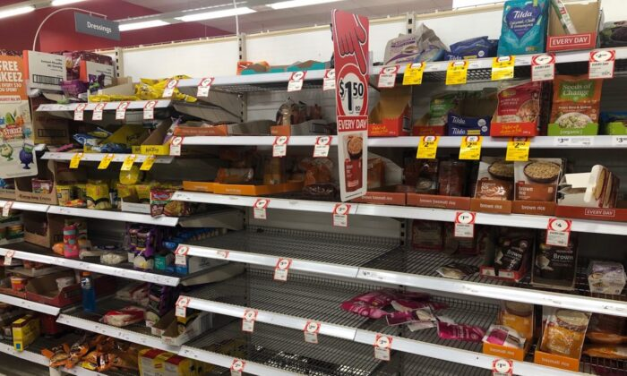A half-empty section of rice at a Coles supermarket in Sydney, Australia, on March 3, 2020. (Mimi Nguyen Ly/The Epoch Times)