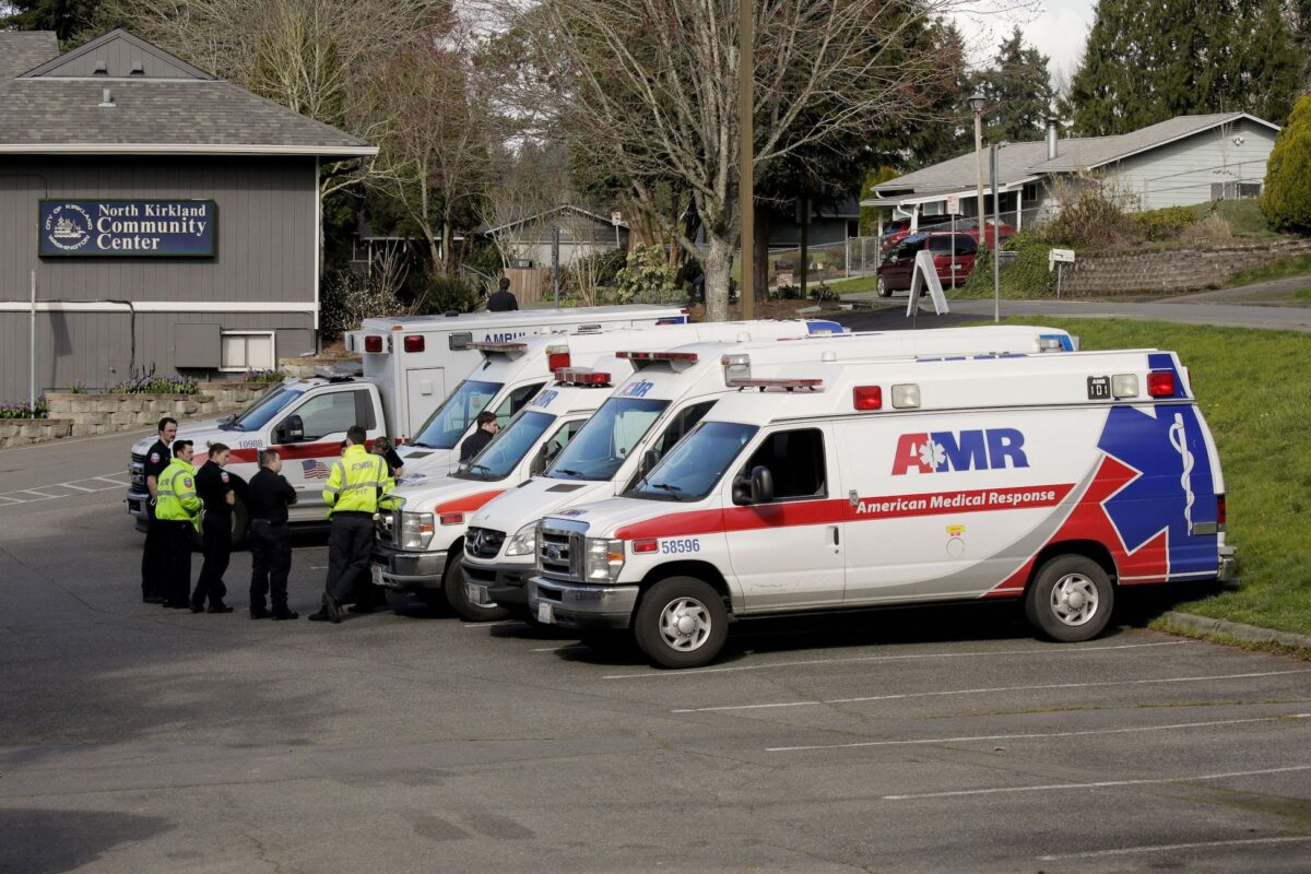 Ambulances are seen in a staging area at the North Kirkland Community Center, which is a short drive from the Life Care Center of Kirkland, the long-term care facility linked to several confirmed coronavirus cases in the state, in Kirkland