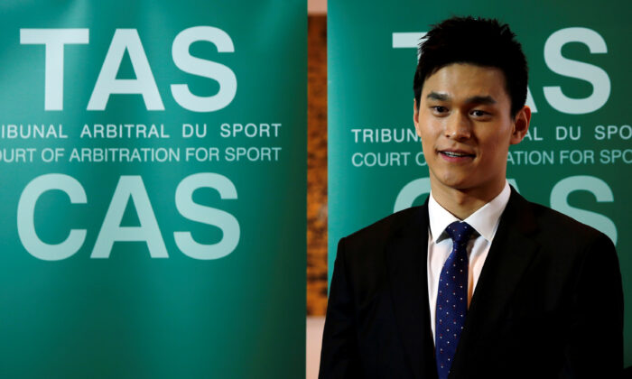 Chinese swimmer Sun Yang poses after a public hearing of the Court of Arbitration for Sport (CAS) for the appeal filed by the World Anti-Doping Agency (WADA) against him and the Federation Internationale de Natation (FINA), at the Conference Centre of the Fairmont Le Montreux Palace, in Montreux, Switzerland, on Nov. 15, 2019. (Denis Balibouse/Reuters)