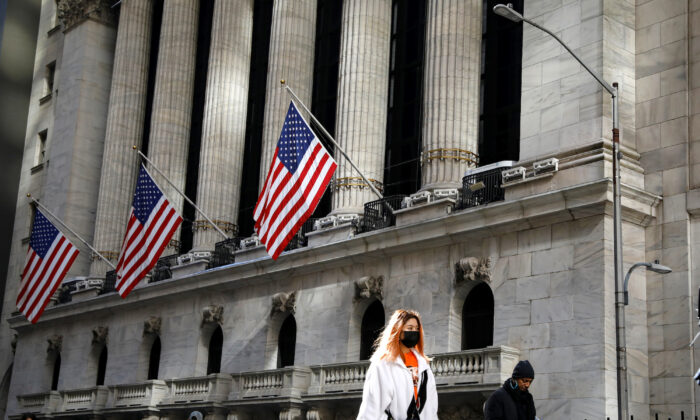 A woman wears a mask near the New York Stock Exchange (NYSE) in the Financial District in New York, on March 4, 2020. (Reuters/Brendan McDermid)