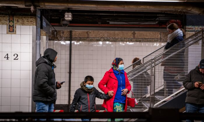 Travelers wear medical masks at Grand Central station in New York City on March 5, 2020. (David Dee Delgado/Getty Images)