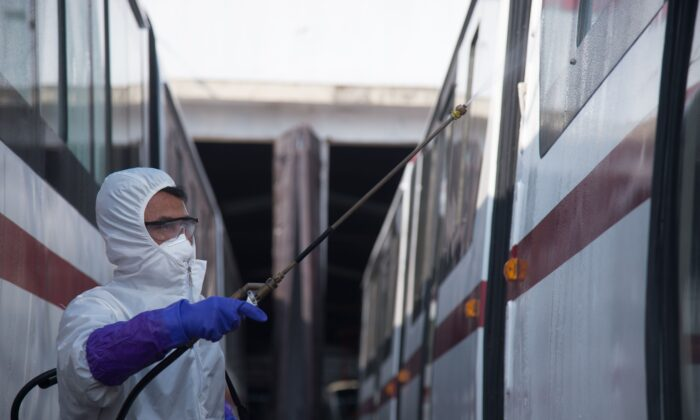 An official from the Mangyongdae District emergency anti-epidemic headquarters disinfects a tramcar to prevent the spread of the COVID-19 coronavirus, at the Songsan Tram Station in Pyongyang on Feb. 26, 2020. (Kim Won Jin/AFP via Getty Images)