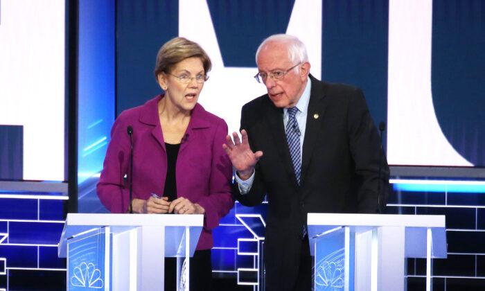 Democratic presidential candidates Sen. Elizabeth Warren (D-Mass.), left, and Sen. Bernie Sanders (I-Vt.), right, take a break during the Democratic presidential primary debate at Paris Las Vegas in Nevada on Feb. 19, 2020. (Mario Tama/Getty Images)