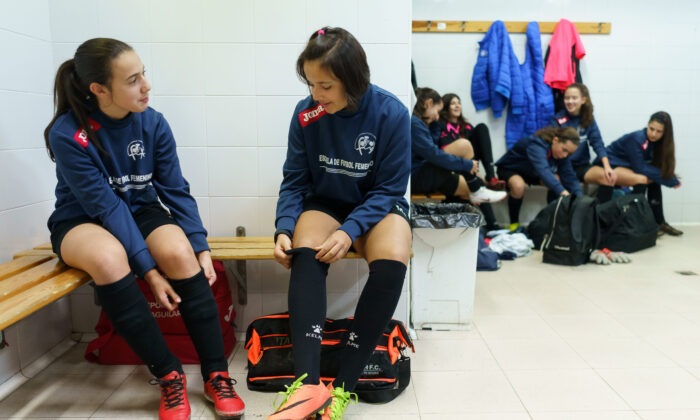 Young girls chat in a locker room before a training session in Valladolid, northern Spain, on Jan. 27, 2019. (Cesar Manso/AFP/Getty Images)