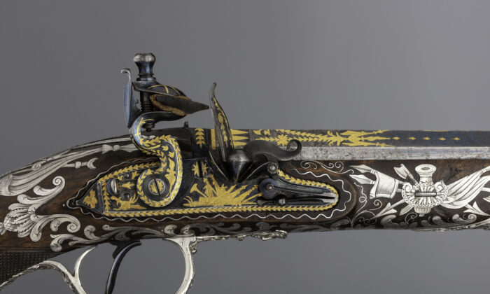 Detail of the flintlock pistol's blued steel lock and barrel engraved and gold-inlaid with trophies of arms and foliage; 1800–1801, by gunmaker Samuel Brunn and silversmith Michael Barnet. British, London. Purchased through the Harris Brisbane Dick Fund and gift of George D. Pratt, by exchange, 1992. (The Metropolitan Museum of Art)