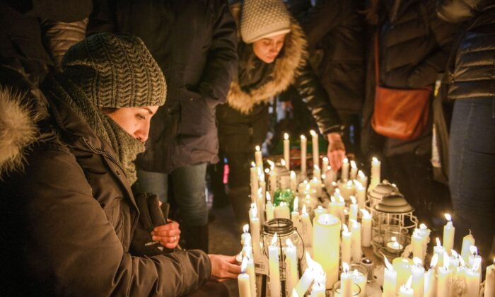 Members of Montreal's Iranian community attend a vigil in downtown Montreal on Jan. 9, 2020, to mourn victims of the Iranian air crash. (The Canadian Press/Andrej Ivanov)